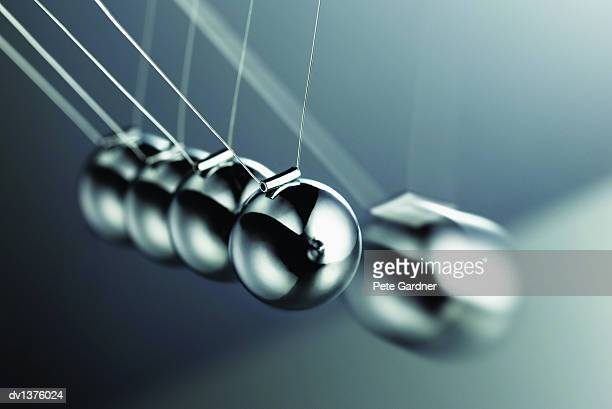 Close Up of the Metallic Balls on a Newton's Cradle