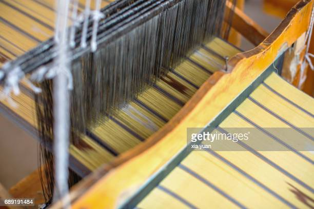 Close up of the patterns on Atlas Silk being weaved,Hotan,China