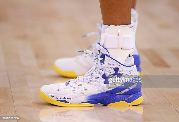 A close up of the shoes that Stephen Curry of the Golden State Warriors wore during their game against the Denver Nuggets at ORACLE Arena on October...