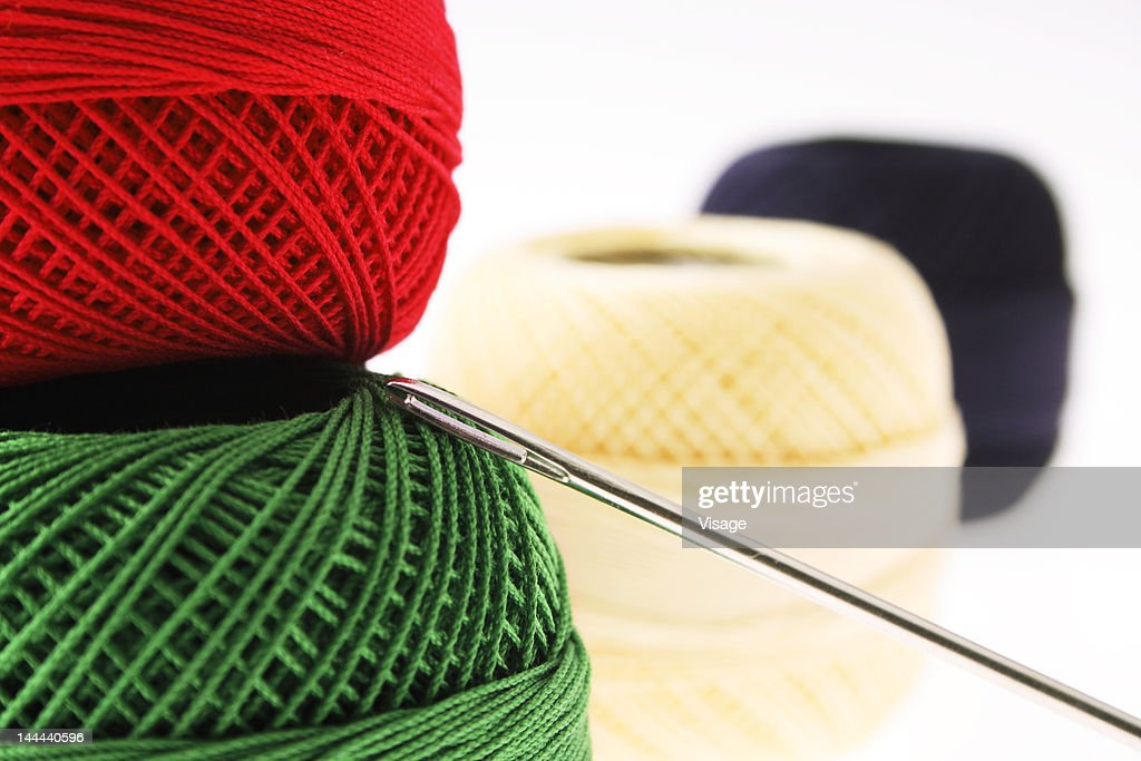 Close up of thread spools with a needle : Stock Photo
