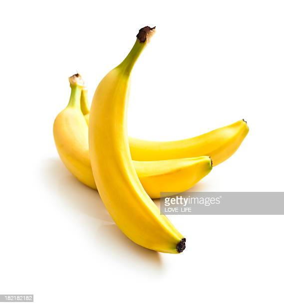 Close up of three fresh bananas on a white background