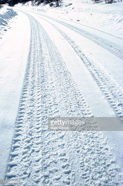 Close up of tire tracks in snowy road, Aspen, CO