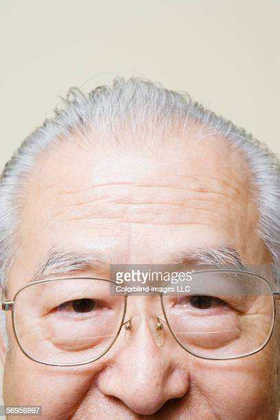 Close up of top half of elderly man's head