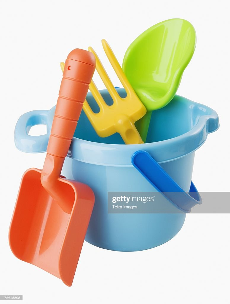 Close up of toy pail and shovels
