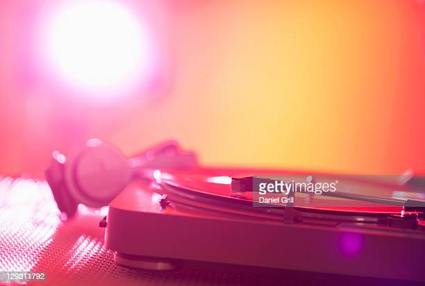 Close up of turntable on colored background