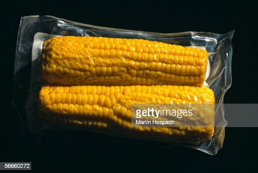 Close up of two corncobs packed in plastic