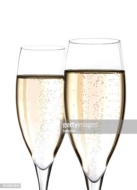 Close up of two flutes of champagne