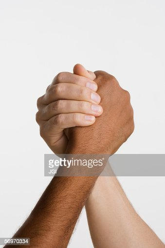 Close up of two hands in arm wrestle