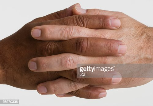 Close up of two hands interlocking