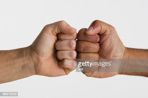 Close up of two hands touching knuckles together