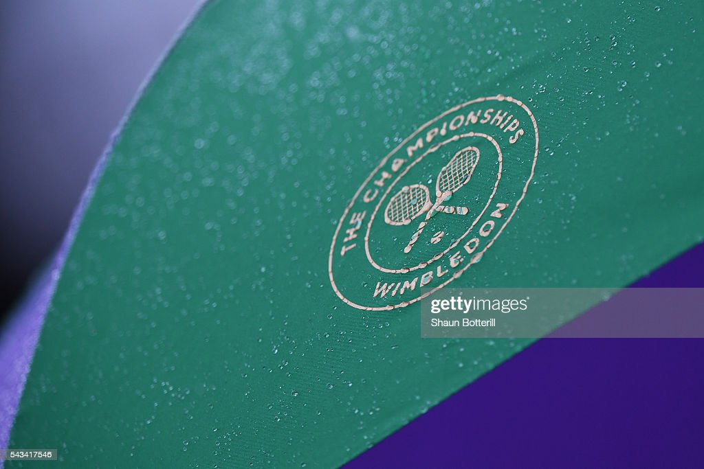 A close up of umpires umbrellas on court one on day two of the Wimbledon Lawn Tennis Championships at the All England Lawn Tennis and Croquet Club on June 28, 2016 in London, England.