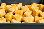 Close up of uncooked butternut squash in tray
