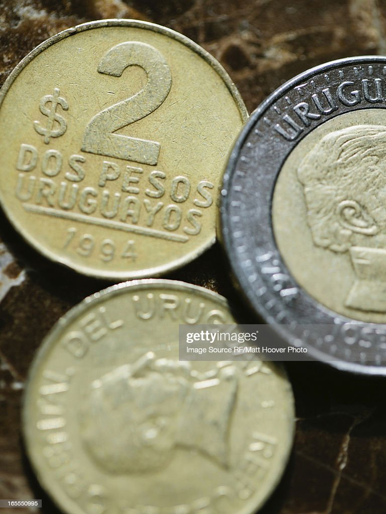 Close up of Uruguayan coins : Stock Photo