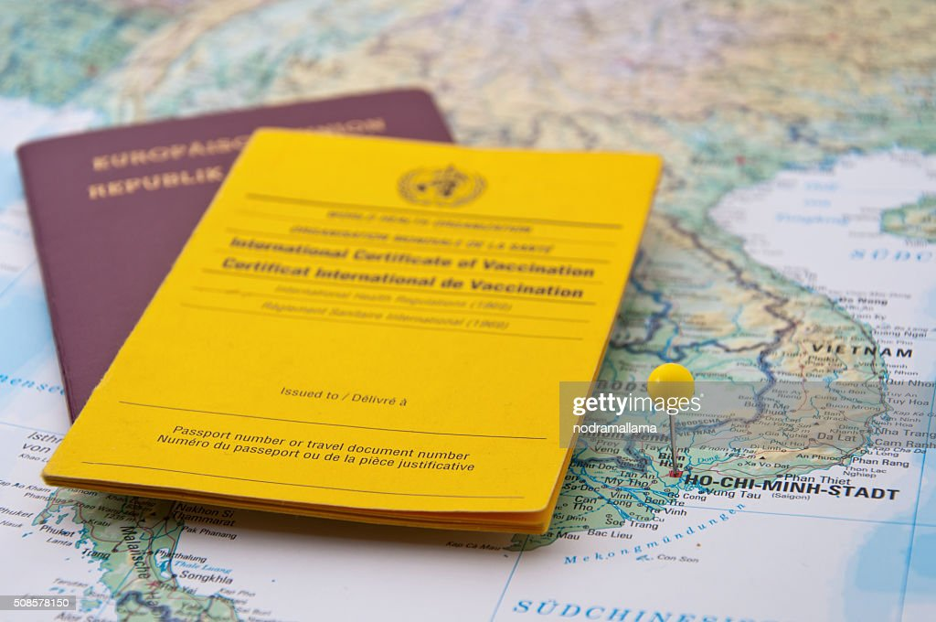 Close Up of Vaccination Certificate, Passport, Ho Chi Minh Pin : Stockfoto
