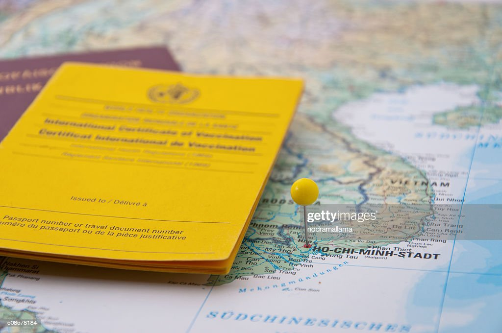 Close Up of Vaccination Certificate, Passport, Ho Chi Minh Pin : Stock Photo