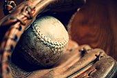 Close up of vintage baseball glove and ball