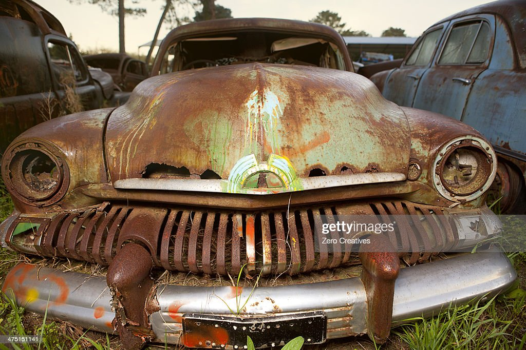 Close up of vintage car in scrap yard
