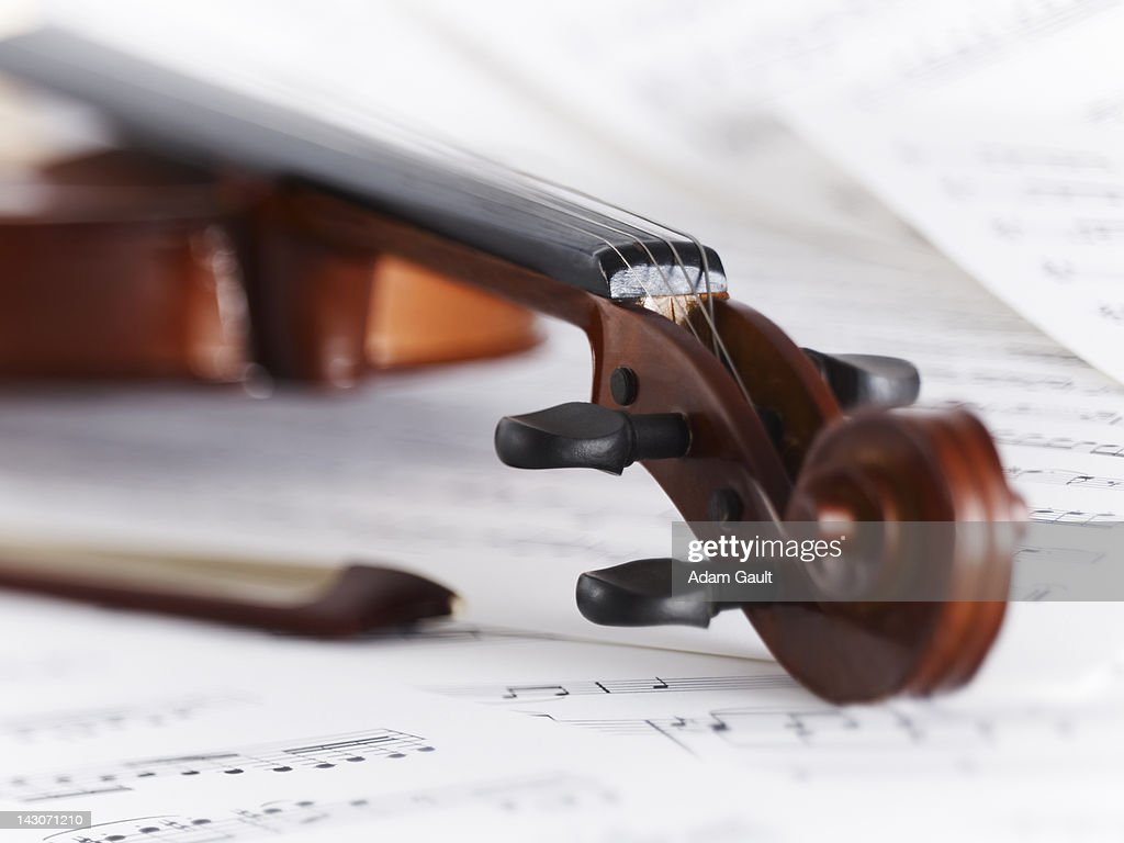 Close up of violin, bow and sheet music : Stock Photo