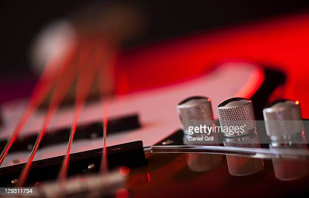 Close up of volume knobs of bass guitar