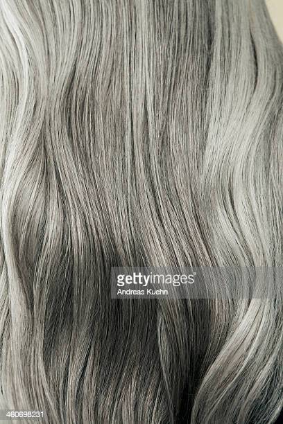 Close up of wavy, long, silver gray hair.