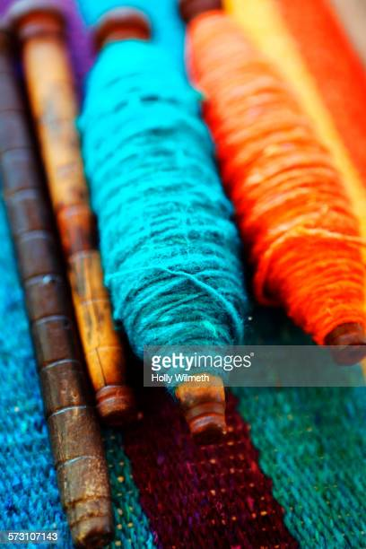 Close up of weaving threads on traditional loom