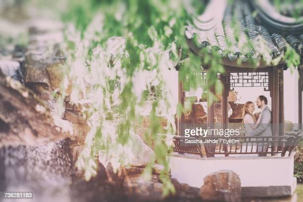 Close Up Of Wedding Couple In Gazebo
