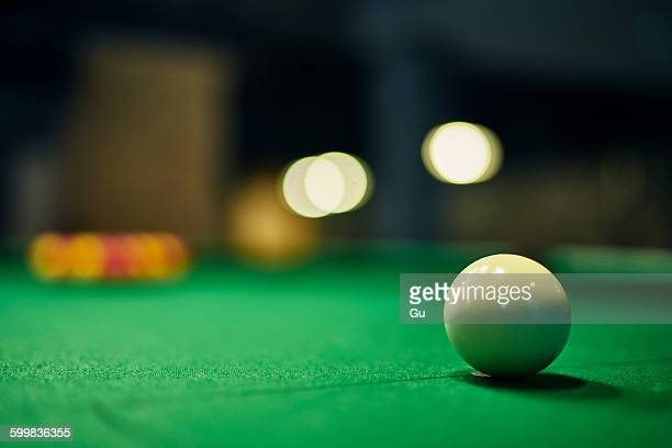 Close up of white cue ball on pool table