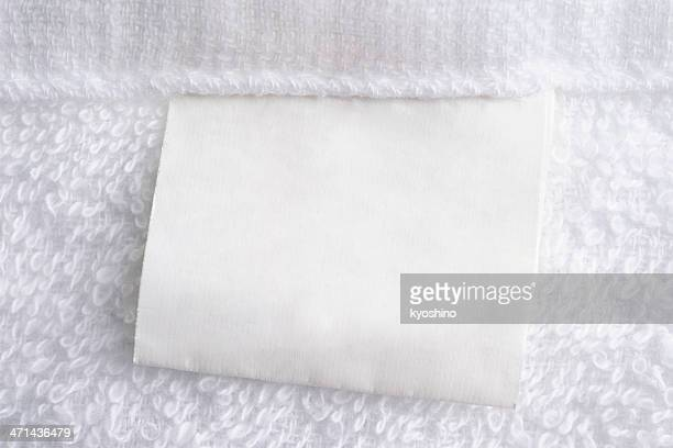 Close up of white towel with blank label