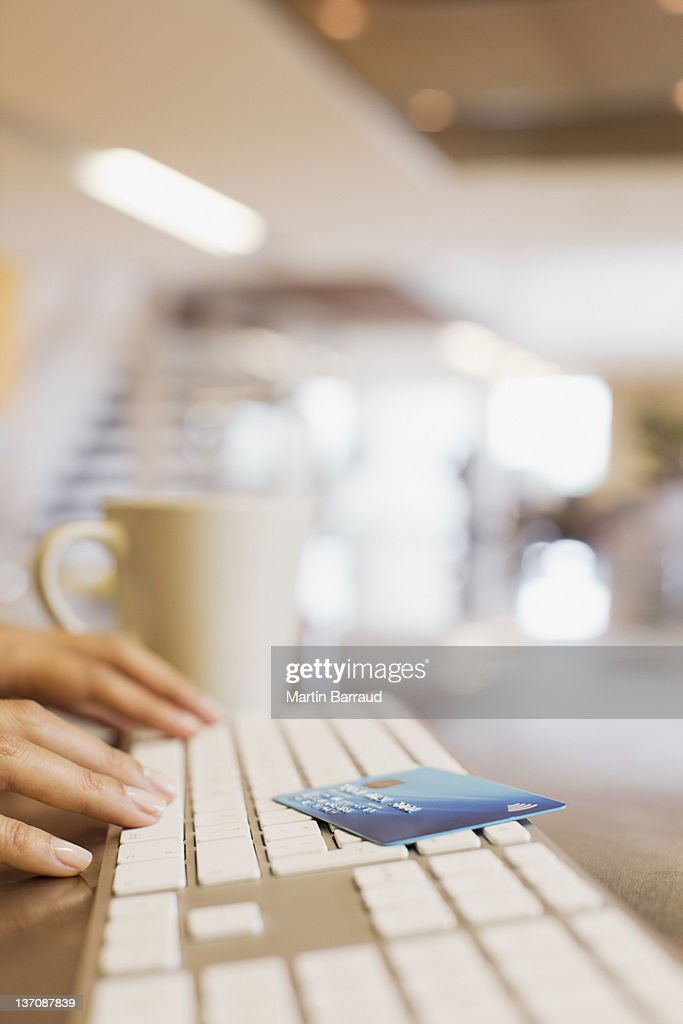Close up of woman credit card and woman typing on keyboard : Stock Photo