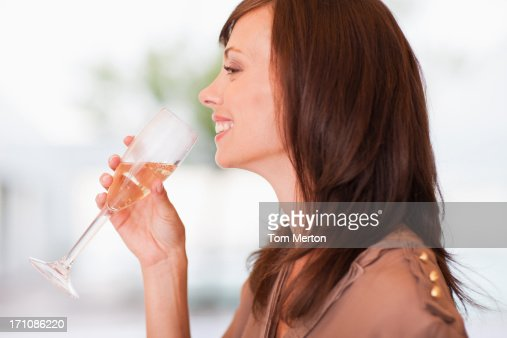 Close up of woman drinking champagne