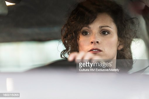Close up of woman driving car