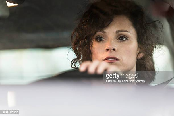 Close up of woman driving car