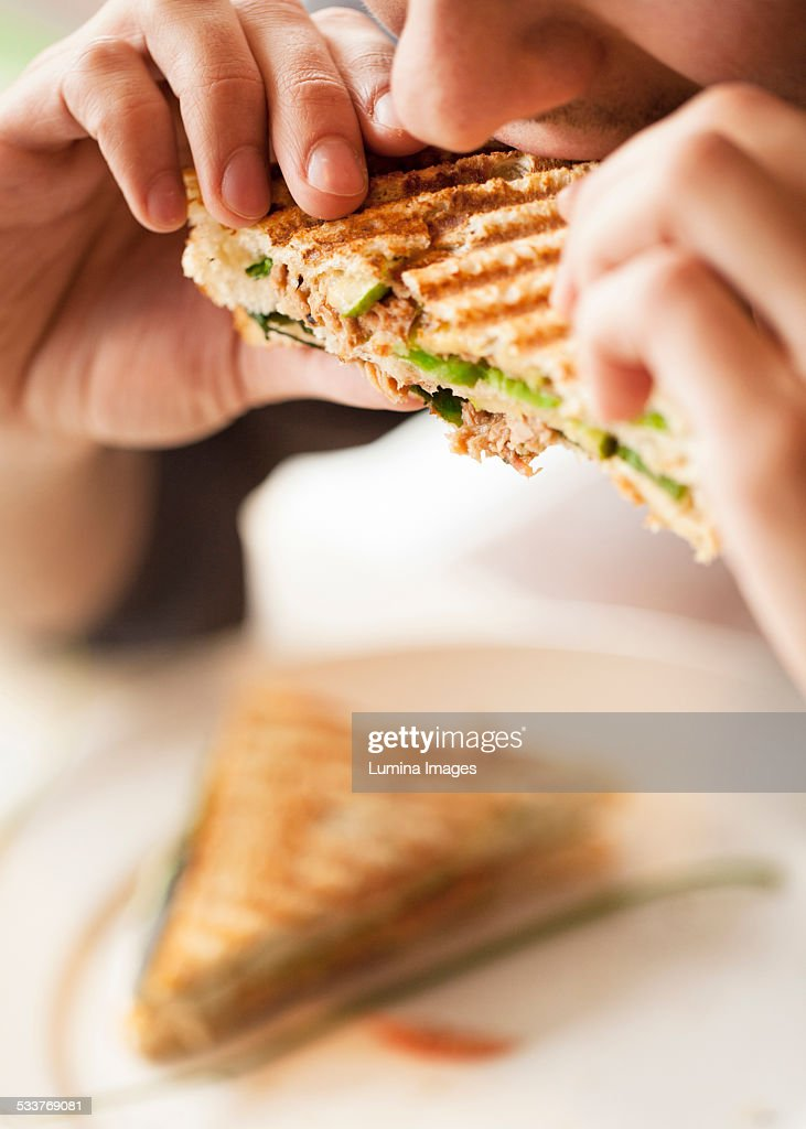 Close up of woman eating sandwich : Stock Photo