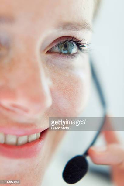 Close up of woman face with headset