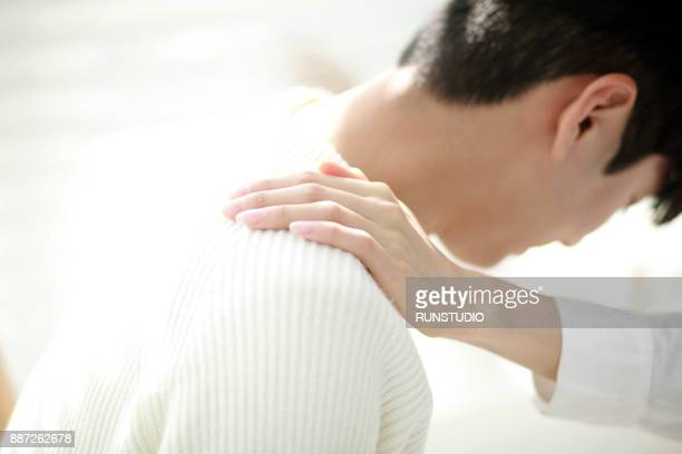 Close up of woman hand consoling man