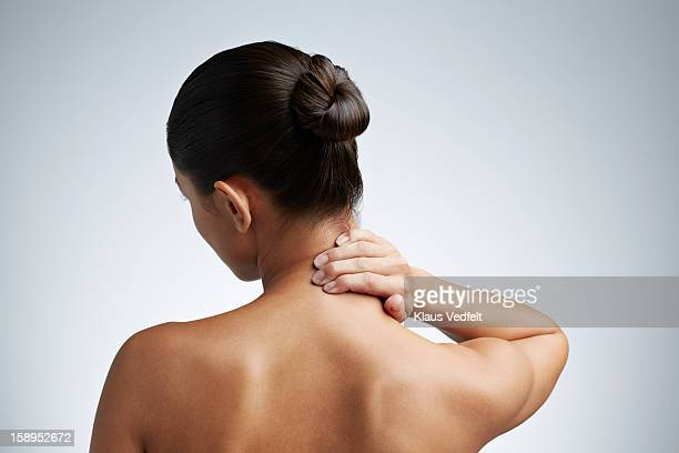 Close up of woman having neck pain