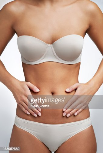 Close up of woman having stomach pain : Stockfoto