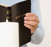Close up of woman holding Spanish bible