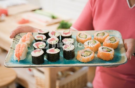 Close up of woman holding tray of sushi : Stock Photo