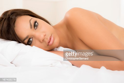 Close up of woman laying on bed : Stockfoto