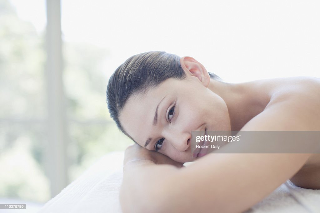 Close up of woman laying on massage table : Stock Photo