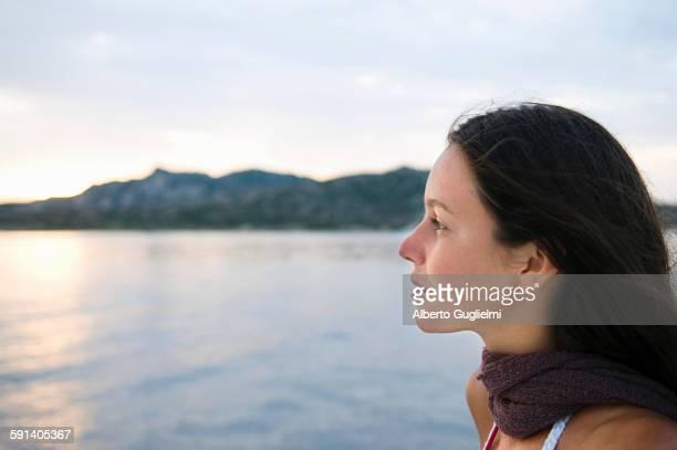Close up of woman overlooking ocean