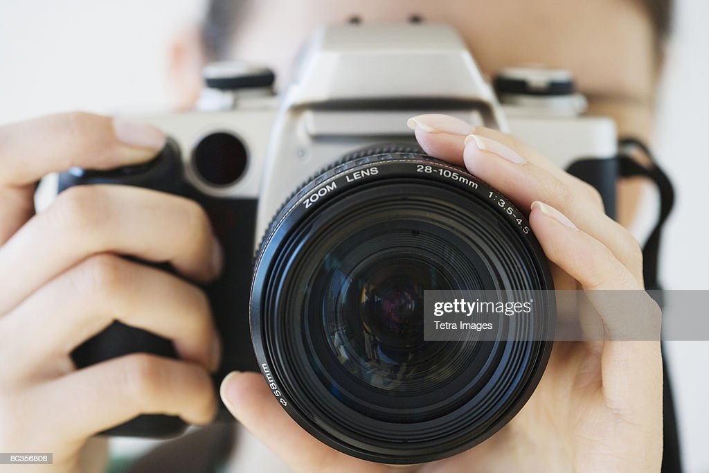Close up of woman pointing camera : Stock Photo