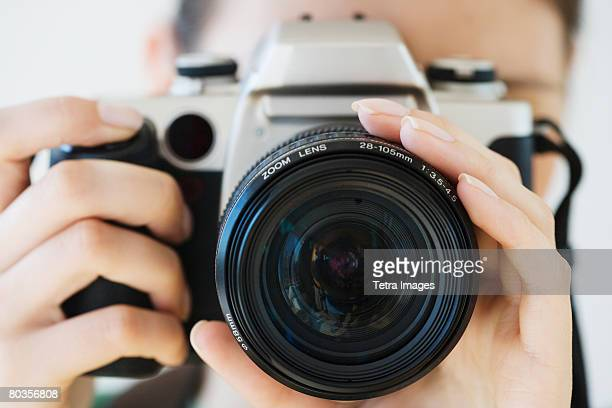 Close up of woman pointing camera