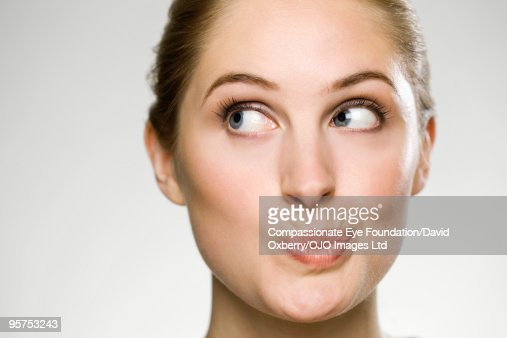 close up of woman puckering her mouth