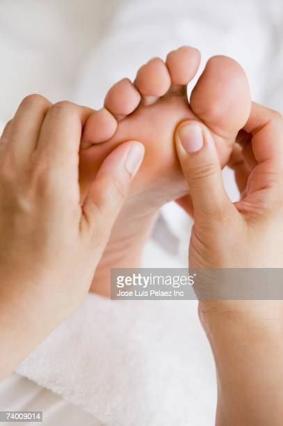 Close up of woman receiving foot massage