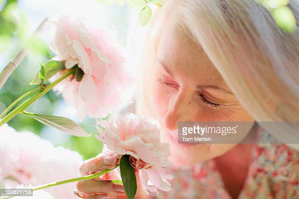 Close up of woman smelling pink flowers