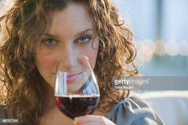 Close up of woman smelling red wine