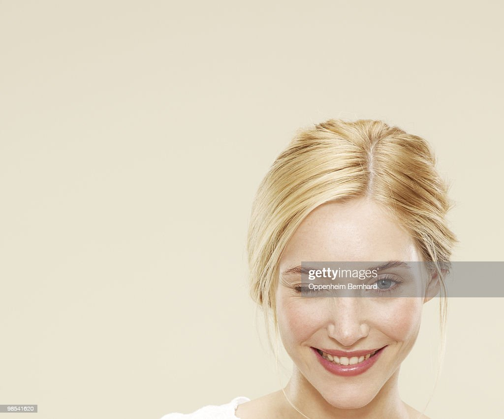 close up of woman smiling and winking  : Stock Photo