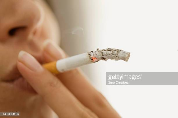 Close up of woman smoking cigarette